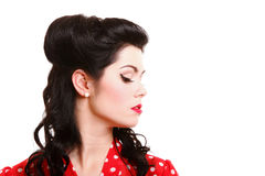 Profile, pin-up girl make-up and vintage hairstyle. Portrait of beautiful young sexy pin-up girl with sparkly make-up and vintage hairstyle profile isolated Royalty Free Stock Image