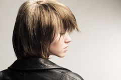 Profile portrait. Studio profile shot of girl in leather jacket royalty free stock photo