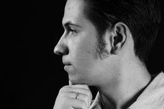Profile portrait. Portrait of the serious young man on a black background Royalty Free Stock Photos