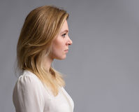 Profile portrait of a beautiful blonde woman Royalty Free Stock Photography