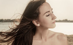 Profile portrait of the beautiful girl close-up Royalty Free Stock Images