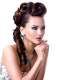 Profile  portrait of a beautiful woman with creative hairstyle Stock Image