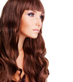 Profile portrait of beautiful woman with long red hairs. Closeup face with curly hairstyle, isolated on white royalty free stock images