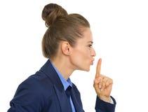 Profile portrait of business woman showing shh Stock Photos