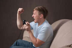 Profile portrait of an excited gamer Royalty Free Stock Images