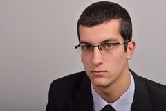 Profile portrait of fashion young man with glasses in black su Royalty Free Stock Photography