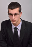 Profile portrait of fashion young man with glasses in black su Royalty Free Stock Image
