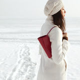 Profile portrait of fashionable model in white coat Royalty Free Stock Photography