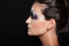 Profile portrait of girl with creative makeup Royalty Free Stock Images