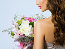 Profile Portrait of a  girl with flowers in hands Royalty Free Stock Photography