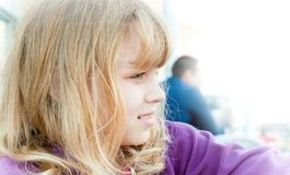Profile portrait of a little blond girl Royalty Free Stock Images