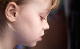 Profile portrait of a little calm girl Stock Images