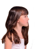 Profile portrait of little girl with long hair stock image