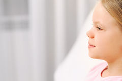 Profile portrait of little girl with long health beautiful hair Royalty Free Stock Photography