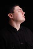 Profile portrait of man on black Stock Photos