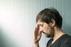 Profile portrait od miserable troubled man Royalty Free Stock Photography