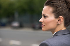 Profile portrait of pensive business woman at office district Royalty Free Stock Photo