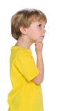 Profile portrait of a pensive little boy Stock Images