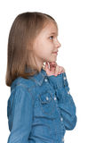 Profile portrait of a pensive little girl Royalty Free Stock Photography