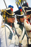 Profile portrait of reenactors dressed in white uniform Royalty Free Stock Image