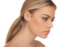 Profile portrait of a serious blond woman Royalty Free Stock Image
