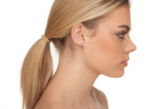Profile portrait of a serious blond woman Stock Photo