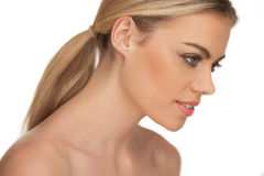 Profile portrait of a smiling blond woman Stock Image