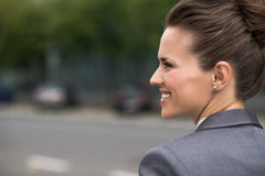 Profile portrait of smiling business woman at office district Royalty Free Stock Photo