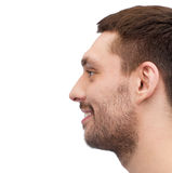 Profile portrait of smiling young handsome man Royalty Free Stock Photography
