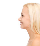Profile portrait of smiling young woman Stock Photography