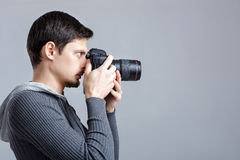 Profile portrait of successful professional photographer use DSL Royalty Free Stock Image