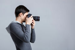 Profile portrait of successful professional photographer use DSL Royalty Free Stock Photography