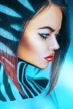 Profile portrait of voluptuous woman in cold tones. In studio Royalty Free Stock Photo
