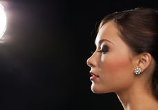 Profile portrait of woman with diamond earrings Royalty Free Stock Images