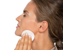 Profile portrait of woman using cotton pads Stock Image