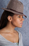 Yong woman in a hat Stock Image