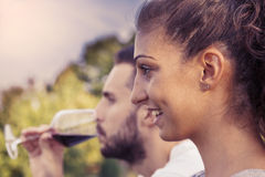Profile portrait of young couple toasts Stock Image