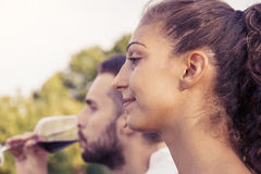 Profile portrait of young couple toasts at sunset Royalty Free Stock Photography