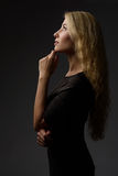 Profile portrait of a young girl positive thinking Royalty Free Stock Images