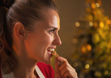 Profile portrait of young housewife eating walnuts Stock Images