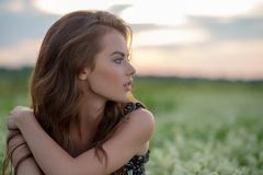 Profile portrait of an Young woman sitting outdoors royalty free stock image