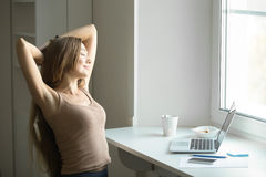 Profile portrait of a young woman, stretching her hands Stock Images