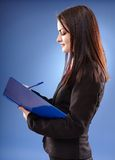Profile pose of a young businesswoman Royalty Free Stock Images