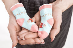 Profile Of Pregnant Woman Holding Baby Small Socks On Hands. Iso Royalty Free Stock Image