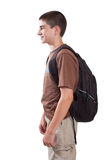 Profile of preteen student. Profile view of a 12 year old boy student carrying a backpack isolated on white Royalty Free Stock Photos