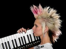 Profile of Punk Musician. Profile of beautiful musician with key-tar isolated over a black background Stock Photos