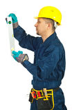 Profile of repairman with bubble level Stock Photos