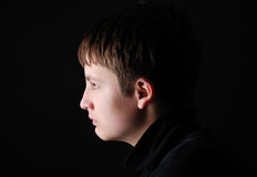 Profile of the sad boy Stock Photos