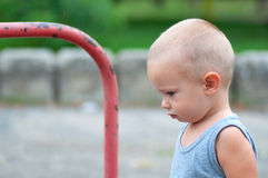 Profile of sad little boy outdoor Stock Photo