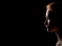 Profile of sad woman Royalty Free Stock Image